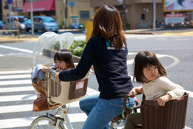 mum-and-two-kids-on-one-bike